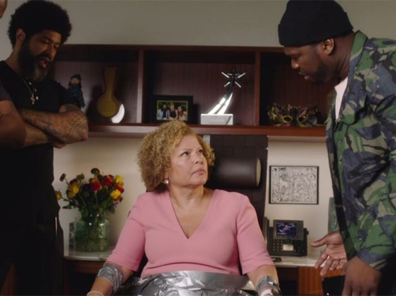50 Cent interrogates an elderly woman in a sketch during 50 Central