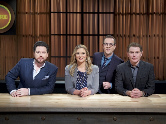 Bobby Flay alongside his panel of judges.