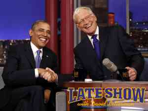 Late Show host David Letterman shakes hands with President Barack Obama