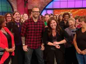 Rachel Ray poses for a picture with her audience members