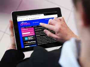 Man Using Telecharge Offers Website on an iPad