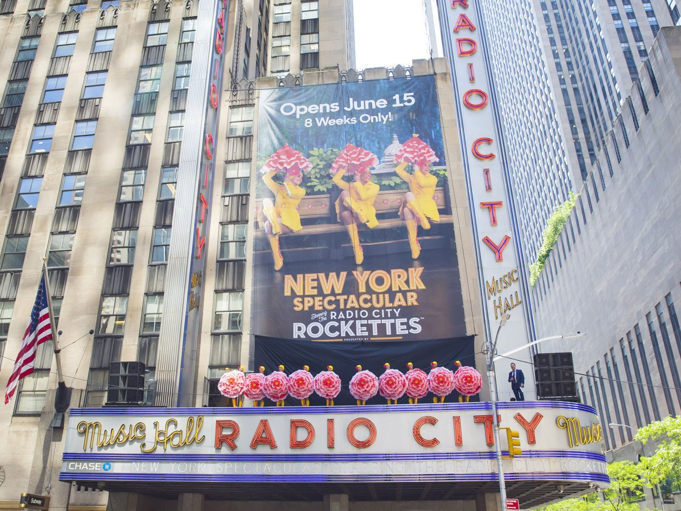 Rockettes stand atop the Radio City Music Hall marquee