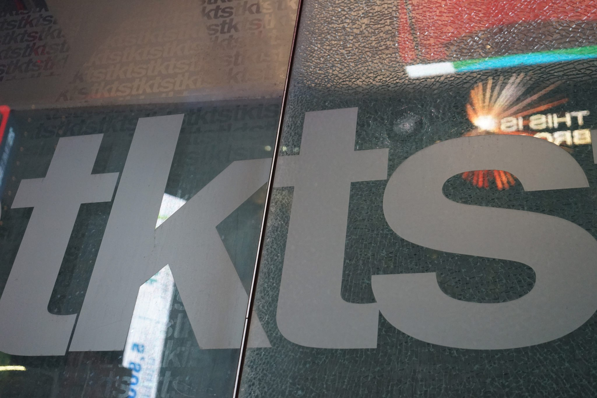 Bullet Hole in TDF TKTS Ticket Stand Times Square NYC